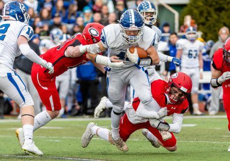 CHESHIRE, CT. 28 November 2019-112819BS1251 - Cheshire's Jake McAlinden (43), left, and Cheshire's Colby Griffin(8), right, tackle Southington's Dillon Kohl (42) as he runs with the ball, during a SCC game and the annual Cheshire vs Southington Thanksgiving game called the Apple Valley Classic at Cheshire High School on Thursday. Southington won 21-20 in double overtime. Bill Shettle Republican-American