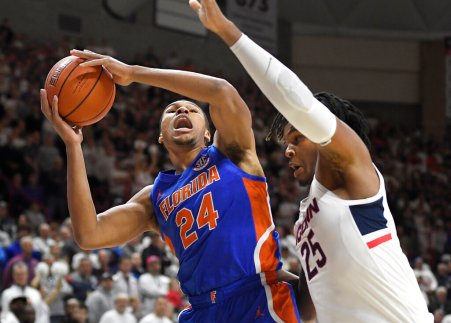 Florida's Kerry Blackshear Jr., left, shoots against Connecticut's Josh Carlton during the first half of an NCAA college basketball game Sunday, Nov. 17, 2019, in Storrs, Conn. (AP Photo/Jessica Hill)