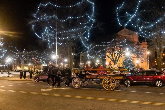 WATERBURY, CT. 08 December 2019-120819BS19 - A horse drawn carriage takes people for rides around the illuminated green, after the annual lighting of the Christmas Tree and surrounding lights on the City Green to help launch the Holiday Season in downtown Waterbury on Sunday. The lighting ceremony was pushed backed on week due to the snowstorm last weekend. Bill Shettle Republican-American