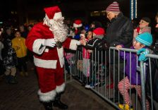 WATERBURY -- Santa arrives greeting kids with gifts and treats, during the annual lighting of the Christmas Tree and the surrounding lights on the City Green to help launch the Holiday Season in downtown Waterbury on Sunday. The lighting ceremony was pushed backed on week due to the snowstorm last weekend. Bill Shettle Republican-American