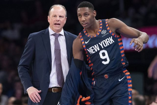 New York Knicks interim head coach Mike Miller gives forward RJ Barrett (9) instructions as he enters the game in the first half of an NBA basketball game against the Indiana Pacers, Saturday, Dec. 7, 2019, at Madison Square Garden in New York. (AP Photo/Mary Altaffer)