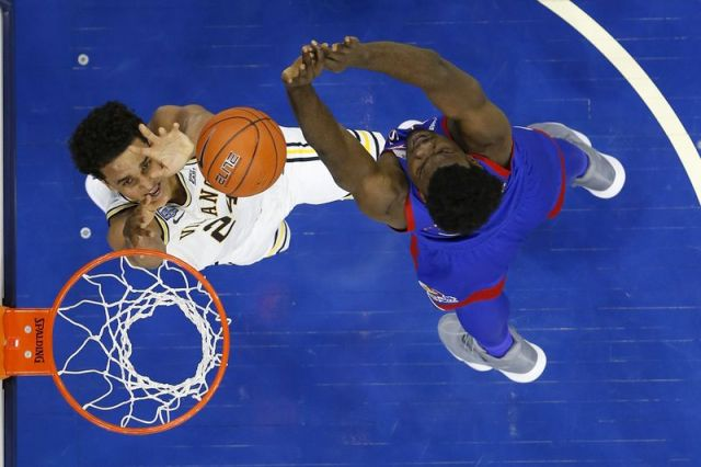 Villanova's Jeremiah Robinson-Earl, left, goes up for a shot against Kansas' Udoka Azubuike during the second half of an NCAA college basketball game, Saturday, Dec. 21, 2019, in Philadelphia. (AP Photo/Matt Slocum)