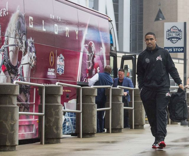 Oklahoma Sooners quarterback Jalen Hurts arrived at the Omni Hotel with the team in Atlanta, Monday, Dec. 23, 2019. The Oklahoma Sooners will face the LSU Tigers in the Chick-fil-A Peach Bowl at Mercedes-Benz Stadium Saturday, December 28. (Alyssa Pointer/Atlanta Journal-Constitution via AP)