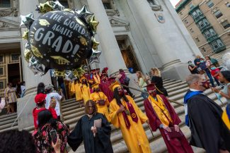 Sacred Heart graduates make their way outside following the 99th, and final, annual commencement exercises for Sacred Heart High School Friday at The Basilica of the Immaculate Conception in Waterbury. Jim Shannon Republican American