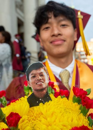 With a bouquet of flowers with a photo fo him in it, Sacred Heart graduate William Nguyen is all smiles following the 99th annual commencement exercises for Sacred Heart High School Friday at The Basilica of the Immaculate Conception in Waterbury. Jim Shannon Republican American