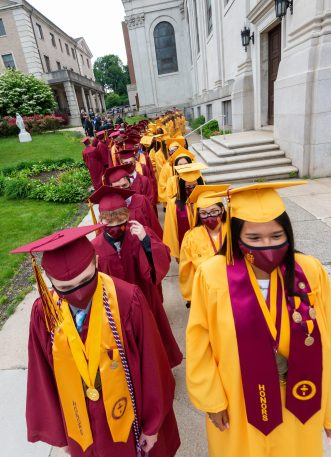 Sacred Heart graduates mile up as they prepare to march in for the 99th annual commencement exercisesFriday at The Basilica of the Immaculate Conception in Waterbury. Jim Shannon Republican American