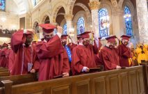 After receiving their diplomas, Sacred Heart graduates move their tassels to the other side of their caps during the 99th annual commencement exercises for Sacred Heart High School Friday at The Basilica of the Immaculate Conception in Waterbury. Jim Shannon Republican American