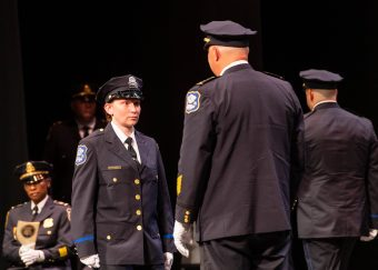 Waterbury Police Academy recruit Brandy Lenois prepares to get her badge pinned on her by Waterbury Police Chief Fernando Spagnolo during basic training graduation ceremonies for the Waterbury Police Academy Class 2021-01 Tuesday at the Palace Theater in Waterbury. Lenois will become a member of the Waterbury Police Department. Jim Shannon Republican American