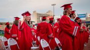 Northwestern Regional High School graduate Alyson Richard throws up a peace sigh to her family after receiving her diploma during graduation ceremonies Wednesday at Dunkin' Donuts Park in Hartford. Jim Shannon Republican American