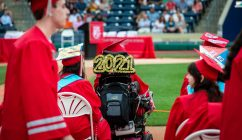 Northwestern Regional High School graduate Emma Burnett decorated her wheelchair with a 2021 sign during graduation ceremonies Wednesday at Dunkin' Donuts Park in Hartford. Jim Shannon Republican American