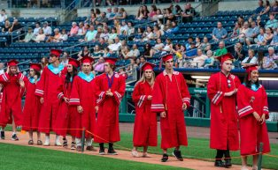 Northwestern Regional High School graduates line up to receive their diplomas during graduation ceremonies Wednesday at Dunkin' Donuts Park in Hartford. Jim Shannon Republican American