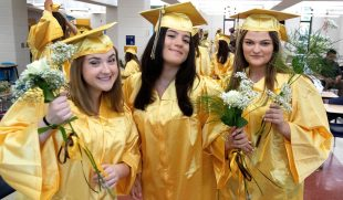 From left; Jordan Curtis, Danielle Ayoub, and Michela Stanly line up for graduation at Thomaston High in Thomaston Wednesday. Steven Valenti Republican-American