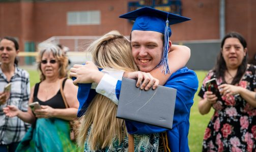 Oliver Wolcott Technical High School graduate Reed Friend, gets a hug from his sister Sadie Monroe following graduation ceremonies at the school on Friday. Monroe came up from her home in Florida for her brothers graduation. The two had not seen each other for two years. Friend, who graduated from the Precision Machining Technology program at the school will be joining the United States Army and will report for basic training at Fort Jackson S.C. Jim Shannon Republican American