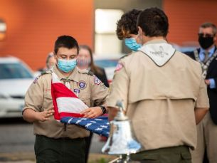 Members of Boy Scout Troop 138 of Naugatuck fold the U.S. flag before raising a flag of honor during 2020's annual 9/11 memorial hosted by Naugatuck Elks Lodge 967. (Jim Shannon Republican-American)