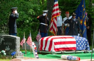 An honor guard, along with Daniel Matthews, commander of VFW Post 296, salute the flag-draped casket of former longtime VFW Commander Neil V. Hunt at Colebrook Center Cemetery on June 18, 2020. (Jim Shannon Republican-American)