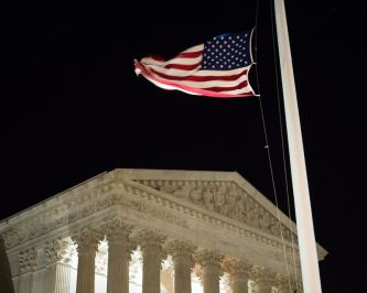 A U.S. flag flies at half-staff in front of the U.S. Supreme Court in Washington on Feb. 13, 2016, after it was announced that Supreme Court Justice Antonin Scalia, 79, had died. (AP Photo/J. David Ake)
