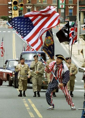 Ziggy Berisha of Waterbury gets the crowd into the spirit during the 2003 Memorial Day Parade in Waterbury. Berisha was honored with a plaque for patriotism after the parade. (Steven Valenti Republican-American)