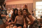 """This image released by Warner Bros. Entertainment shows, from left, Melissa Barrera, Stephanie Beatriz, Leslie Grace, Dascha Polanco, background, and Daphine Rubin-Vega in a scene from """"In the Heights."""" (Macall Polay/Warner Bros. Entertainment via AP)"""