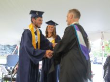 Brandon Sorrell and Justine Allyn are presented the Good Citizenship Medals from Housatonic Valley Regional High School Principal Ian Strever during graduation Thursday in Falls Village. Ruth Epstein Republican-American