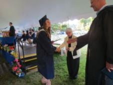 Marguerite Bickford receives her diploma from Region 1 Board of Education Chairwoman Patricia A. Mechare and Assistant Principal Steven Schibi during Housatonic Valley Regional High School's graduation Thursday in Falls Village. Ruth Epstein Republican-American