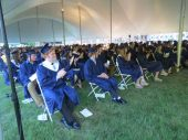 The class of 2021 at Housatonic Valley Regional High School applauds a speaker during Thursday's graduation ceremony under a tent on the school's front lawn in Falls Village. A total of 67 students received their diplomas. Ruth Epstein Republican-American