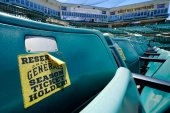 A sticker marking a season ticket holder seat for the Jackson Generals remains on a seat back in The Ballpark at Jackson, Tuesday, June 22, 2021, in Jackson, Tenn. When Major League Baseball stripped 40 teams of their affiliation in a drastic shakeup of the minor leagues this winter, Jackson lost the Jackson Generals, the Double-A affiliate of the Arizona Diamondbacks. (AP Photo/Mark Humphrey)