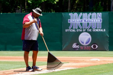 Matt Malone, turf manager as well as director of stadium operations at The Ballpark at Jackson, grooms the infield before a home game for the Winnipeg Goldeyes of the American Association, on Tuesday, June 22, 2021, in Jackson, Tenn. When Major League Baseball stripped 40 teams of their affiliation in a drastic shakeup of the minor leagues this winter, Jackson lost the Jackson Generals, the Double-A affiliate of the Arizona Diamondbacks. The Goldeyes are playing their home games in Jackson due to COVID-19 restrictions. (AP Photo/Mark Humphrey)