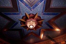 The iconic light fixture is seen on the ceiling of the renovated theater in 2002. (Archives)