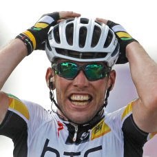 FILE - In this Friday July 8, 2011 file photo Mark Cavendish of Britain celebrates as he crosses the finish line to win the seventh stage of the Tour de France cycling race over 218 kilometers (135.5 miles) starting in Le Mans and finishing in Chateauroux, central France. (AP Photo/Laurent Cipriani, File)