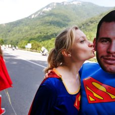 FILE - In this July 8, 2016 file photo, people dressed in Superman suits, one wearing a mask with the face of Britain's sprinter Mark Cavendish, wait for the pack to pass during the seventh stage of the Tour de France cycling race over 162.5 kilometers (100.7 miles) with start in L'Isle-Jourdain and finish in Lac de Payolle, France, Friday, July 8, 2016. Mark Cavendish has saved the best for the end: matching cycling legend Eddy Merckx's record of 34 Tour de France stage wins at the twilight of his storied career. (AP Photo/Christophe Ena, File)