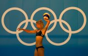 Germany's Laura Ludwig throws the ball during a Beach Volleyball training session ahead of the 2020 Summer Olympics, Tuesday, July 20, 2021, in Tokyo. (AP Photo/Mark Baker)