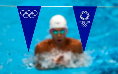 Athletes exercise during a swimming training session at the Tokyo Aquatics Centre at the 2020 Summer Olympics, Wednesday, July 21, 2021, in Tokyo, Japan. (AP Photo/Martin Meissner)