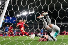 Japan's goalkeeper Sakiko Ikeda falls as Canada's players celebrate after Canada's Christine Sinclair scores a goal against Japan during a women's soccer match at the 2020 Summer Olympics, Wednesday, July 21, 2021, in Sapporo, Japan. (AP Photo/Silvia Izquierdo)