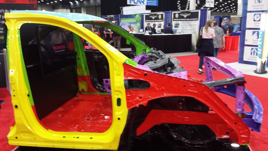 The 1,500-megapascal ultra-high-strength-steel door ring of a 2014 Acura MDX is shown in yellow at the July NACE|CARS show. (John Huetter/Repairer Driven News)