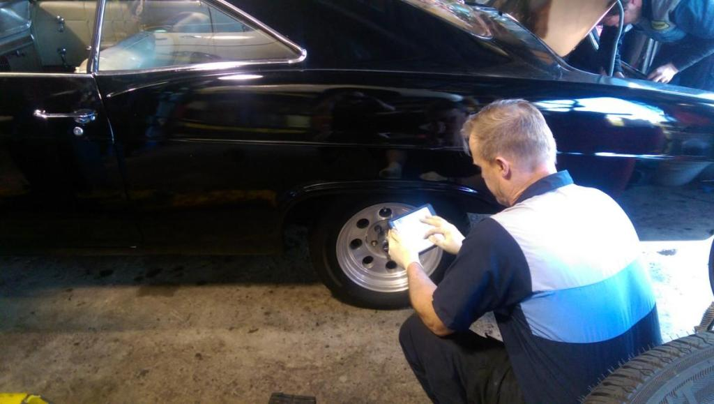 "A Meineke technician prepares an ""e-inspection"" of a car using a table. (Provided by Meineke)"