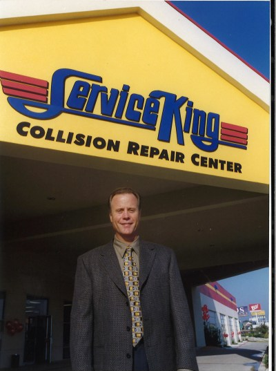 Service King founder Eddie Lennox poses outside of the multi-store operator's headquarters in Texas. (Provided by Service King)