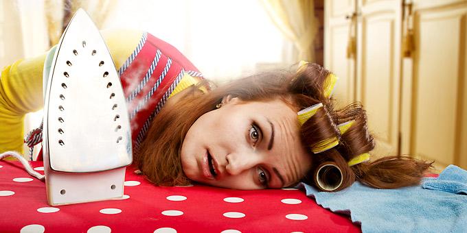 Woman sad while doing chores, housework