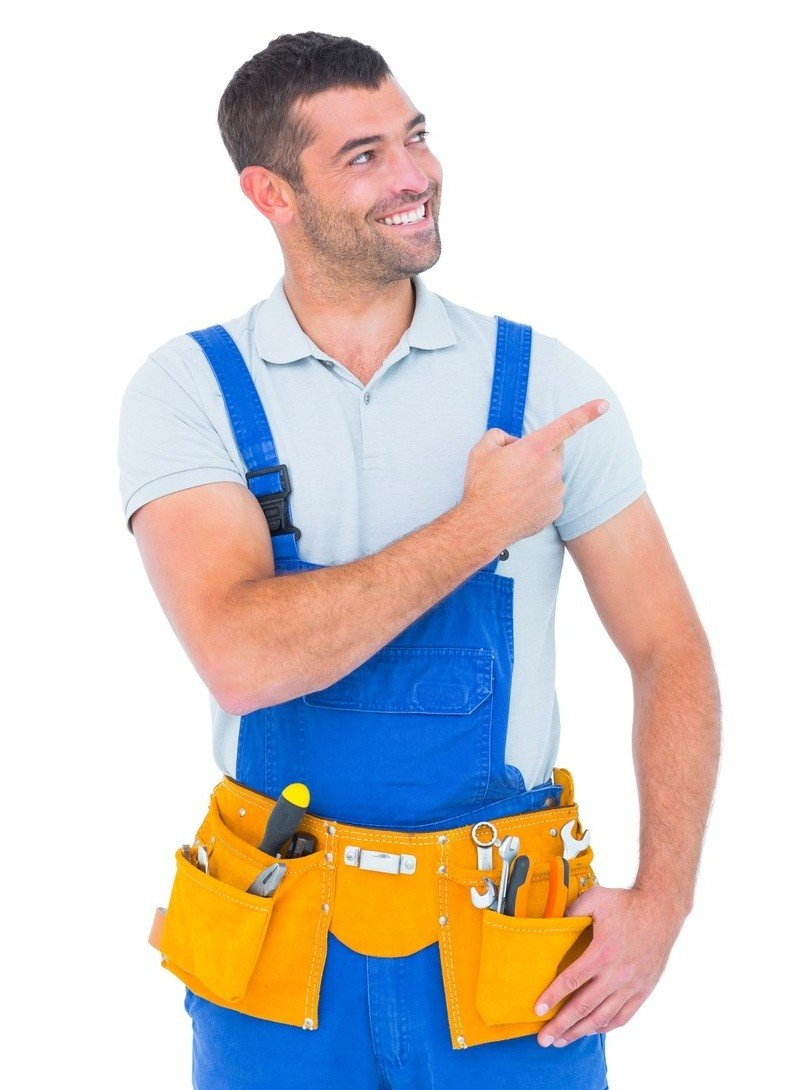 Repairman in overalls pointing on white background