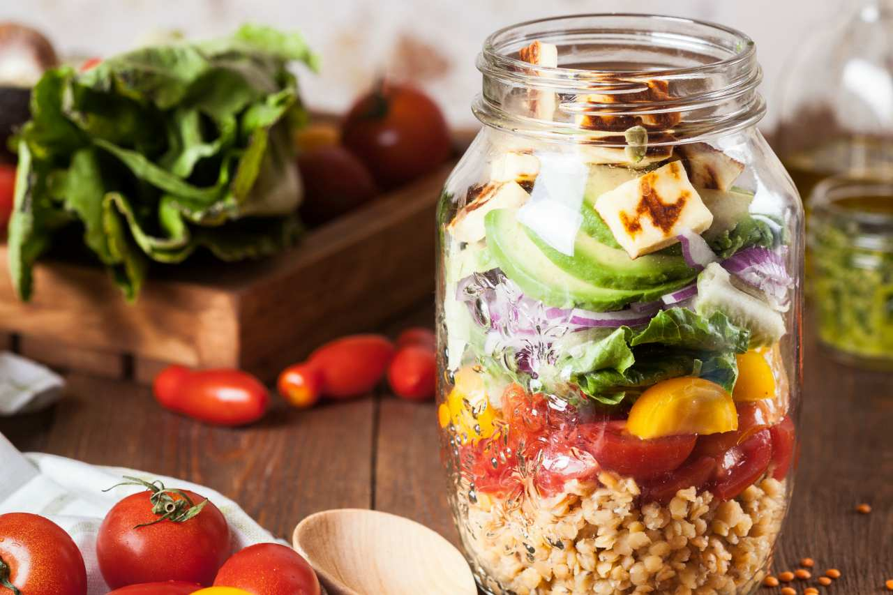 An image of a healthy meal layered in a jar