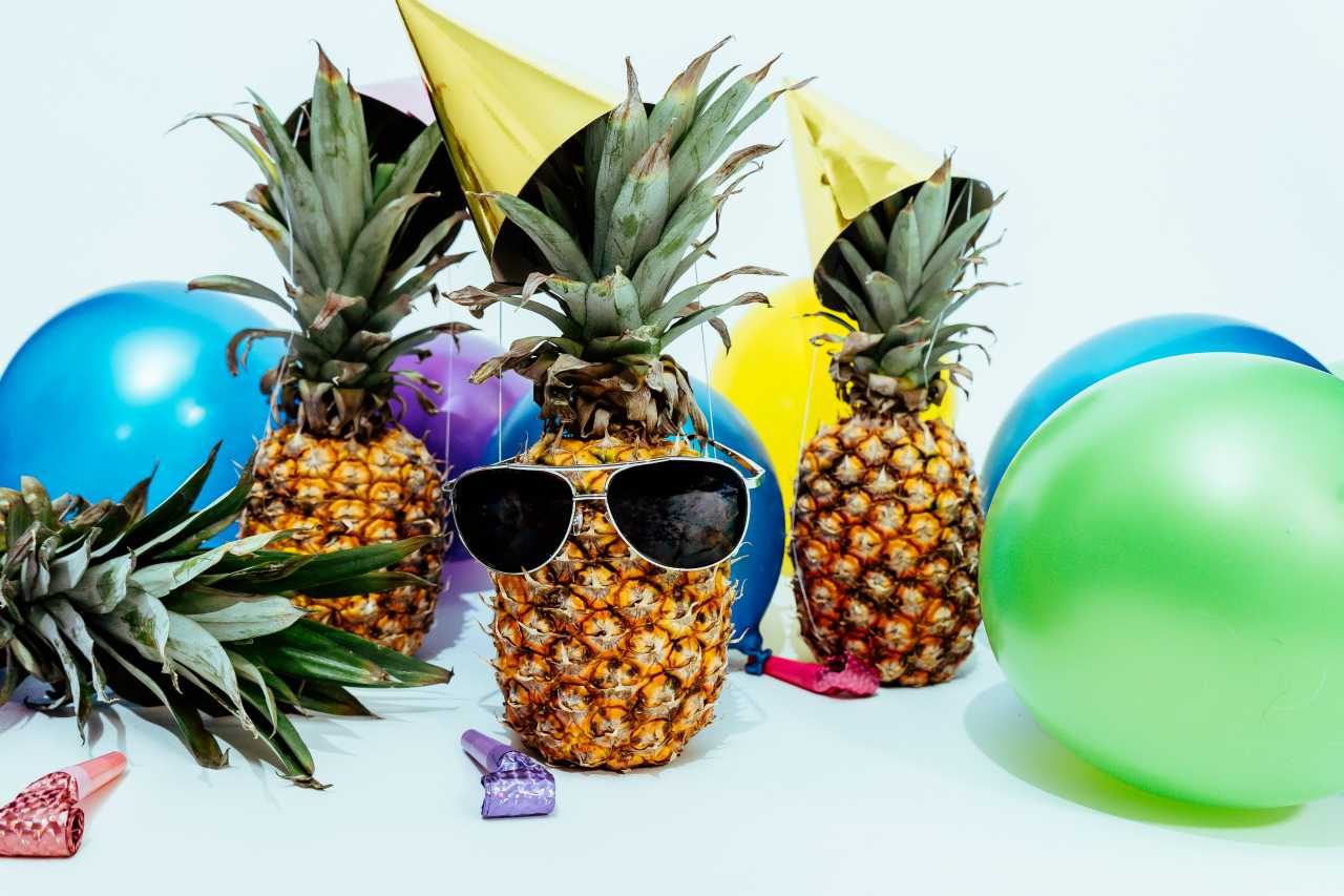 An image of pineapples having a party