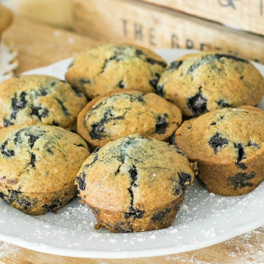 An image of a plate of blueberry lemon muffins
