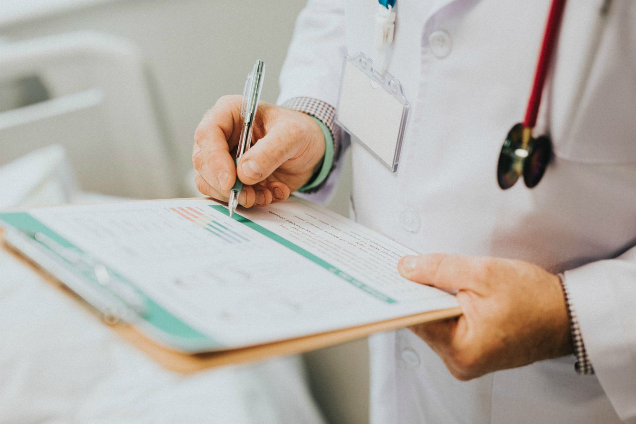 An image of a doctor taking notes on a clipboard