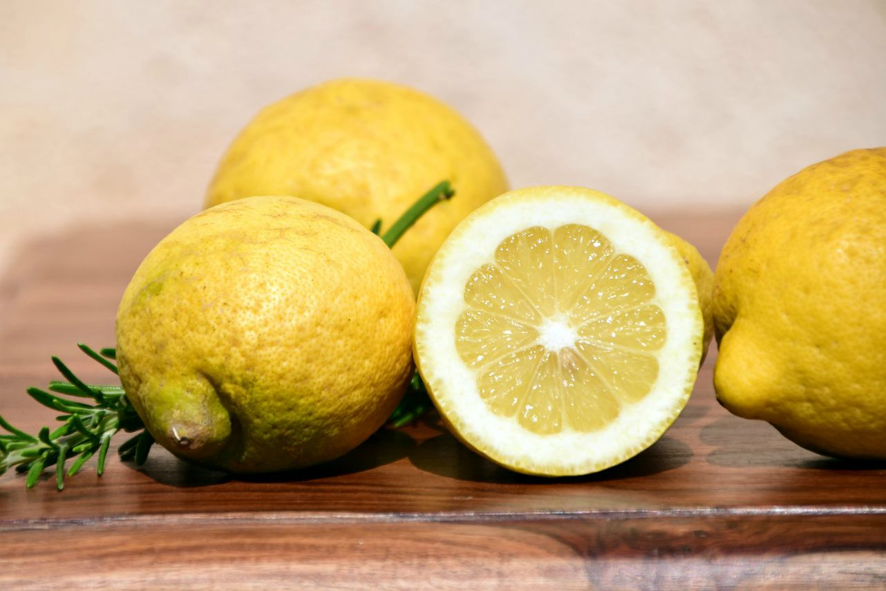 An image of lemons on a chopping board