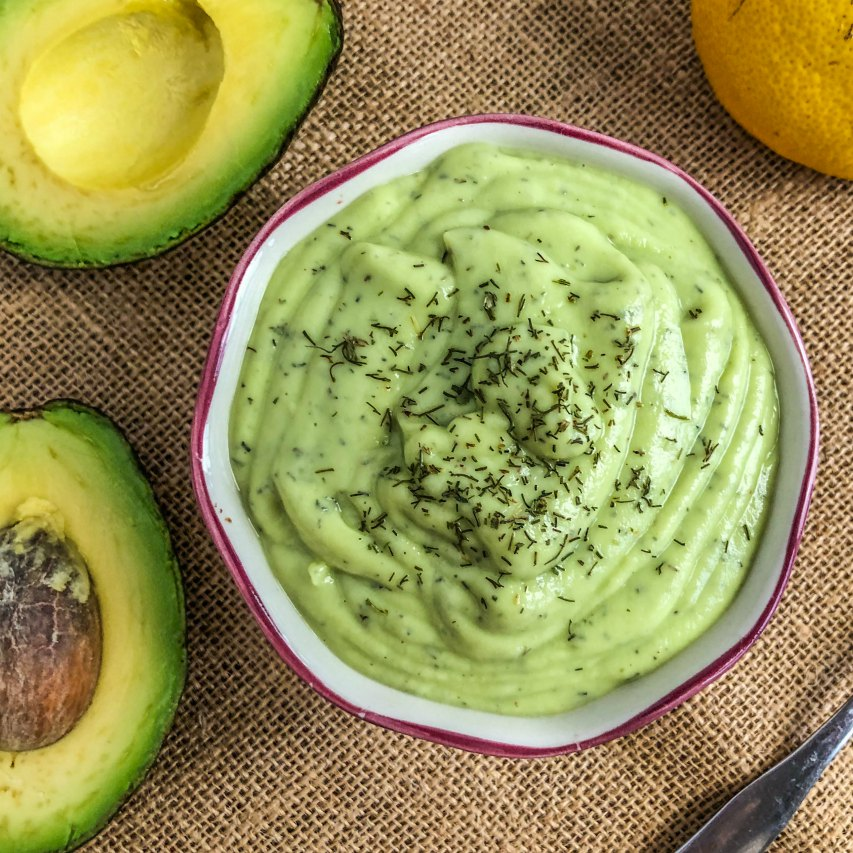 An image of a bowl of Avocado Lemon Dill Salad Dressing