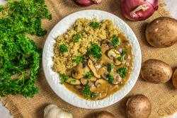An image of a bowl of mushroom stroganoff with quinoa.