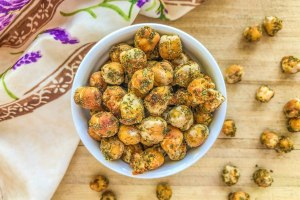 An image of a bowl of cool ranch baked chickpeas.