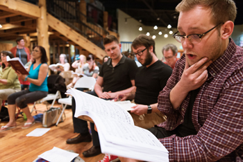 Zack Winkler studies his score along with the rest of the chorus at the Madama Butterfly reherasal.