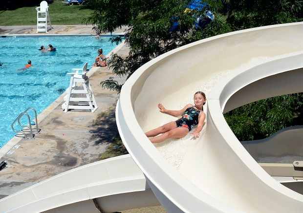 Helen Ingham, 10, beats the heat going down the slide Monday at Winona Pool in Loveland. Starting Monday, the pool will be closed weekdays. (Jenny Sparks/Loveland Reporter-Herald)