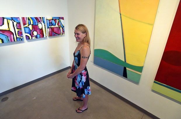 LOVELAND, CO - SEPTEMBER 17, 2019: Artist Tedi Jensen talks Tuesday, Sept. 17, 2019, about her process of using aerial photos to create her abstract pieces on display as part of the Sometimes Landscape, Mostly Abstract exhibit at Artworks in downtown Loveland. (Jenny Sparks/Loveland Reporter-Herald)
