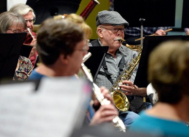 LOVELAND, CO - SEPTEMBER 26, 2019: Dennis McKernan plays the alto saxophone while rehearsing with the New Horizons Concert Band on Thursday, Sept. 26, 2019, at the Good Shepherd Church in Loveland. (Jenny Sparks/Loveland Reporter-Herald)